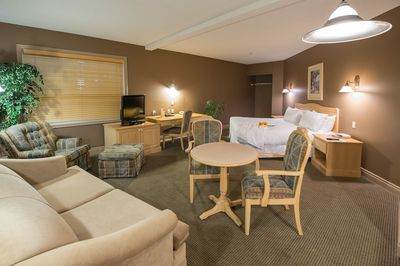 Podollan Inn Fort McMurray Suite with Couch & Dining Area